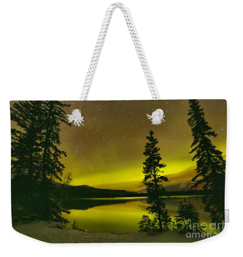 Weekender Tote Bag featuring the photograph Northern Lights Over The Pines by Adam Jewell