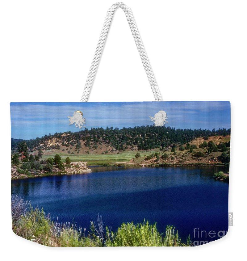 Northern New Mexico Lake Weekender Tote Bag featuring the photograph Northern New Mexico Lake by Bob Phillips