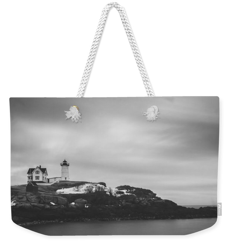 Nubble Lighthouse Weekender Tote Bag featuring the photograph Nubble Lighthouse Overcast Bw by Michael Ver Sprill