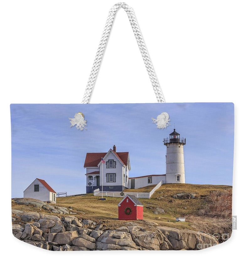 Light Weekender Tote Bag featuring the photograph Nubble Lighthouse York Maine by Edward Fielding