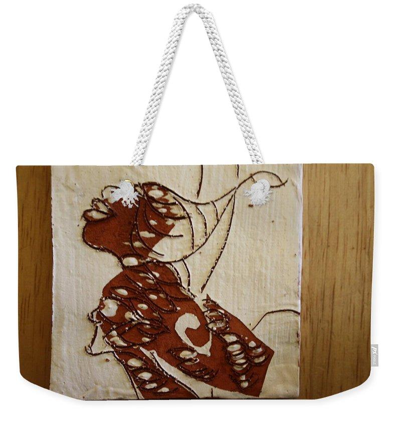Jesus Weekender Tote Bag featuring the ceramic art Nude 12 - Tile by Gloria Ssali