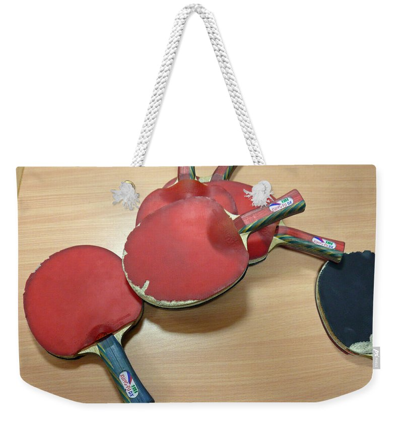 Table Weekender Tote Bag featuring the photograph Number Of Ping Pong Bats Piled On A Table by Ashish Agarwal
