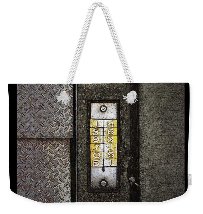 Numbers Weekender Tote Bag featuring the photograph Numbers On The Sidewalk by Tim Nyberg