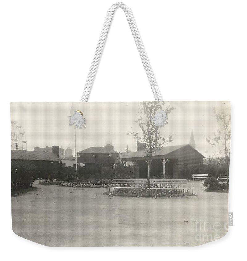 New York Weekender Tote Bag featuring the photograph N.y. Worlds Fair 3 by Michael Krek