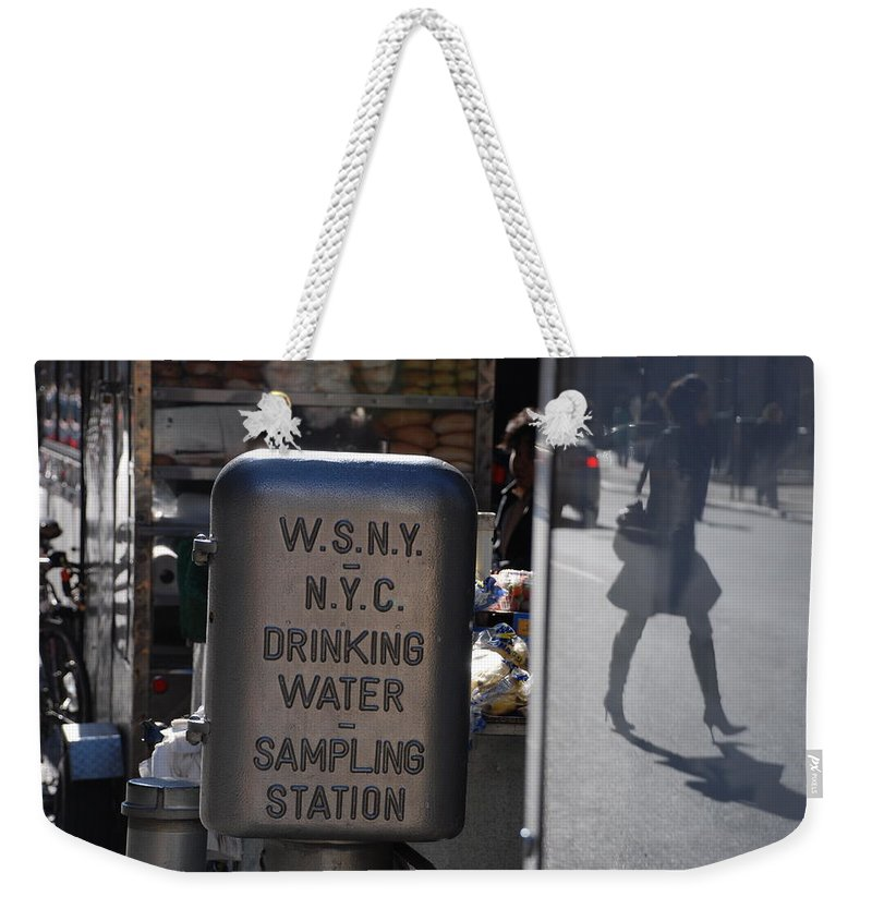 Street Scene Weekender Tote Bag featuring the photograph Nyc Drinking Water by Rob Hans