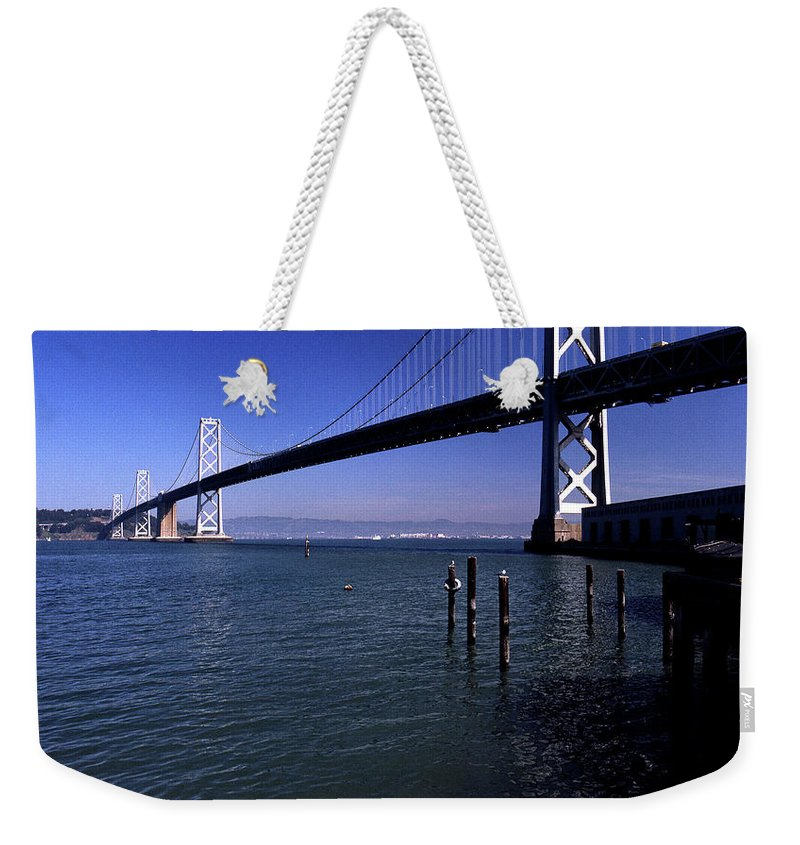 San Francisco Weekender Tote Bag featuring the photograph Oakland Bay Bridge 1985 by Lee Santa