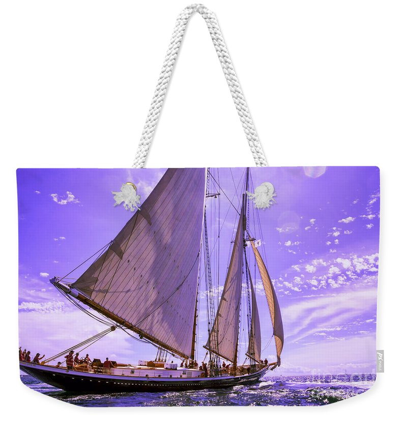 Amistad Weekender Tote Bag featuring the photograph Off And Running by Joe Geraci