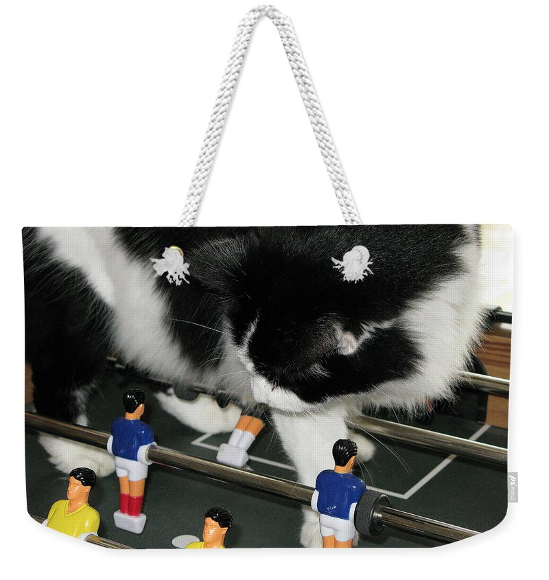 Cat Kong Weekender Tote Bag featuring the photograph Off Side by Maria Joy