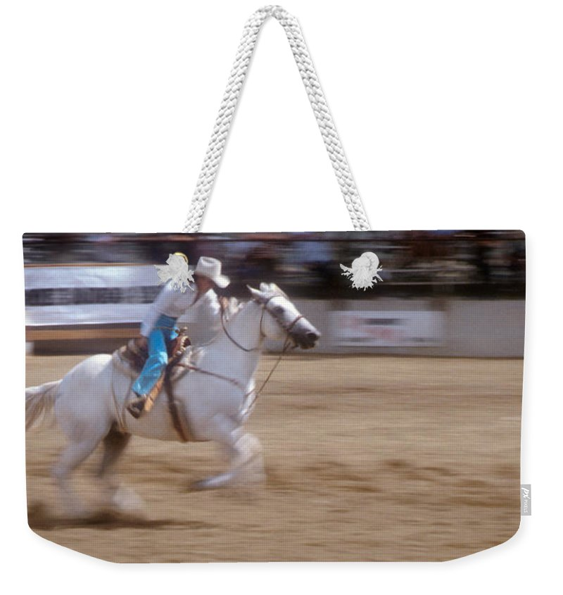 Rodeo Weekender Tote Bag featuring the photograph Off To The Races by Jerry McElroy