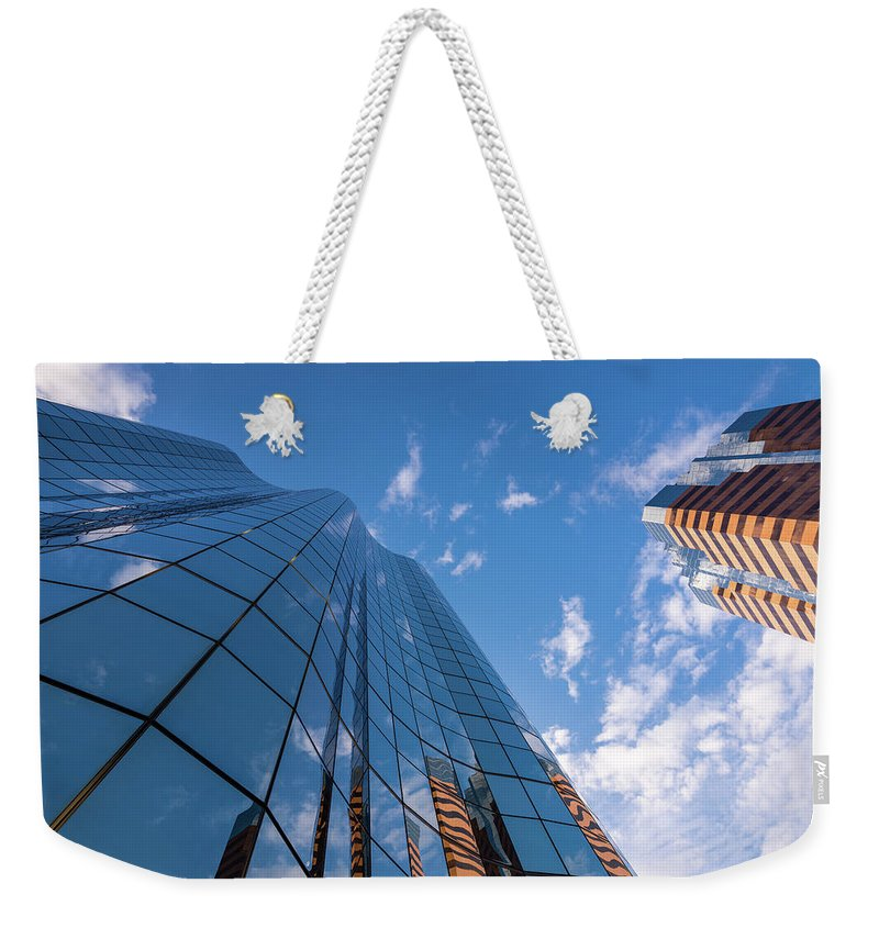 Architecture Weekender Tote Bag featuring the photograph Office Buildings And Sky by Bradley Hebdon