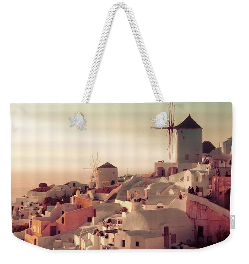 Sunset Weekender Tote Bag featuring the photograph Oia Sunset by Debra Cox