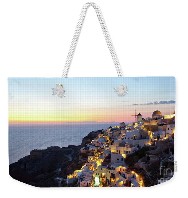 Aegean Weekender Tote Bag featuring the photograph Oia Village In Santorini Island - Greece by Antonio Gravante