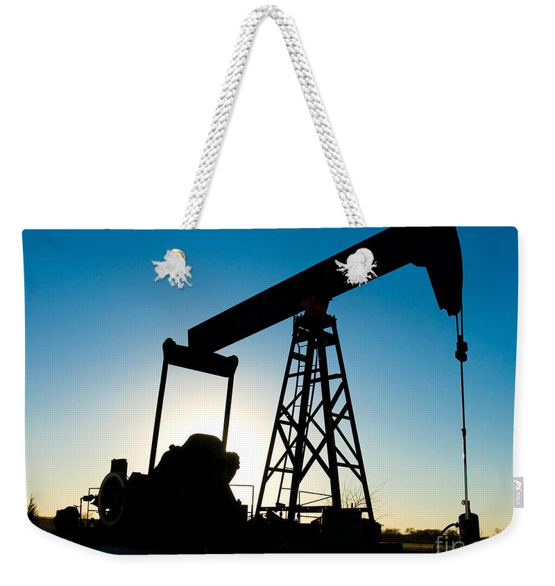 Crude Oil Weekender Tote Bag featuring the photograph Oil Rig Silhouette by Anthony Totah