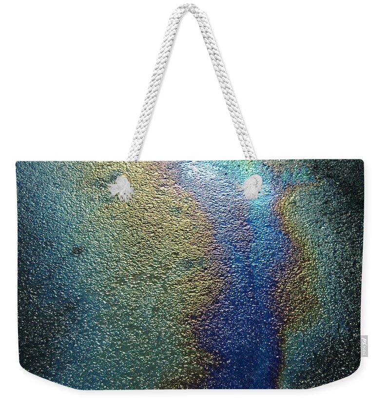 Oil Weekender Tote Bag featuring the photograph Oil Slick by Trish Hale