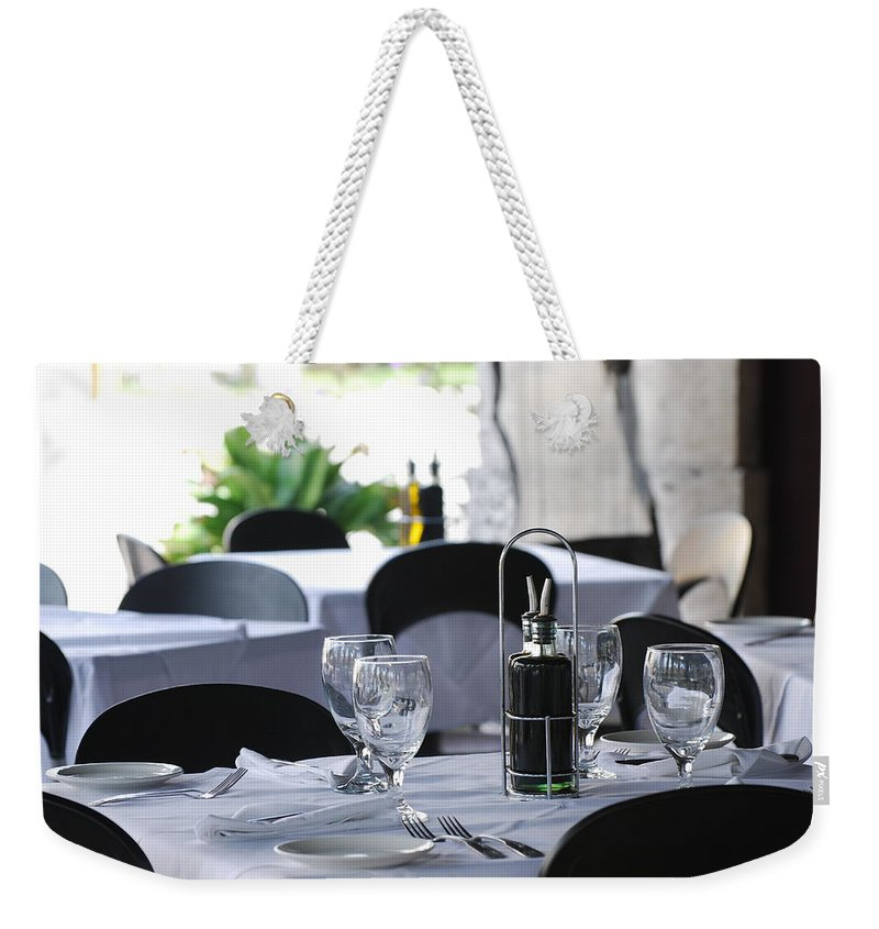 Tables Weekender Tote Bag featuring the photograph Oils And Glass At Dinner by Rob Hans