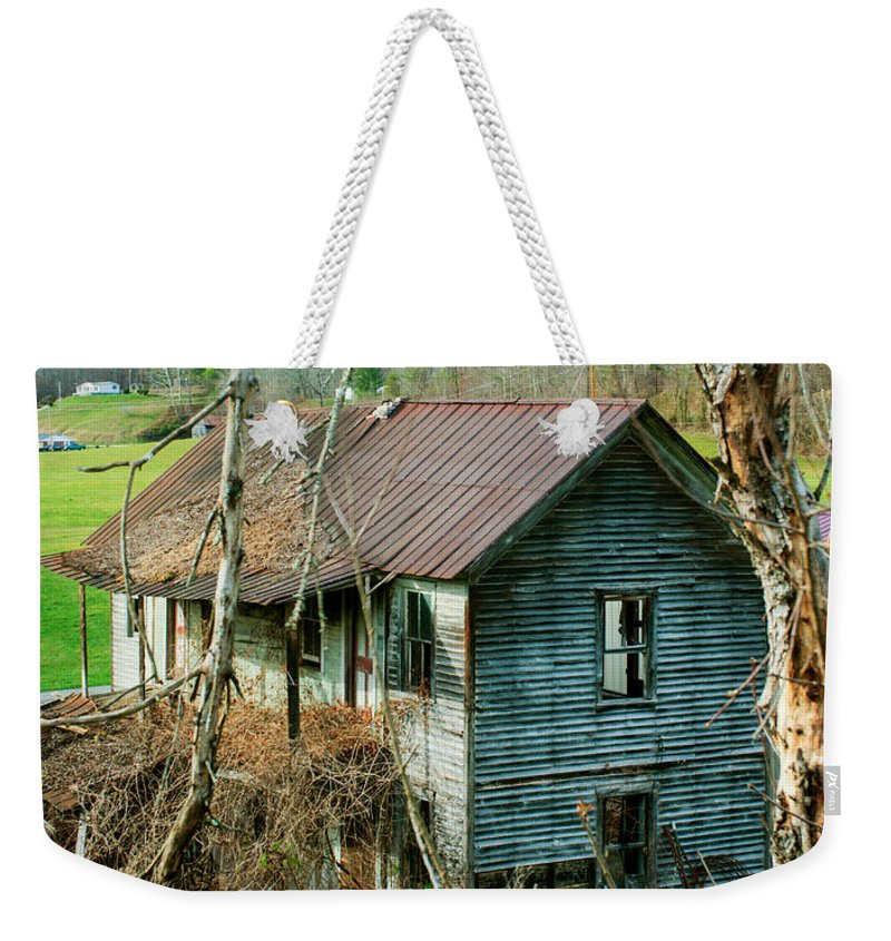 Farm Weekender Tote Bag featuring the photograph Old Abandoned Rural Hose by Douglas Barnett