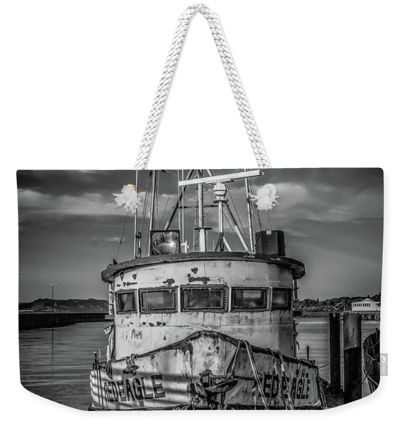 Boats Weekender Tote Bag featuring the photograph Old Battered Fishing Boat by Jason Brooks