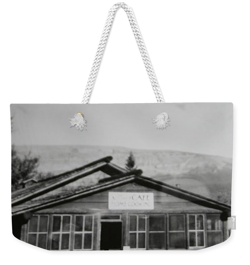 Black And White Photograph Classic Old Cafe Banff Alberta 1950s Diner Log Cabin Weekender Tote Bag featuring the photograph Old Cafe by Andrea Lawrence