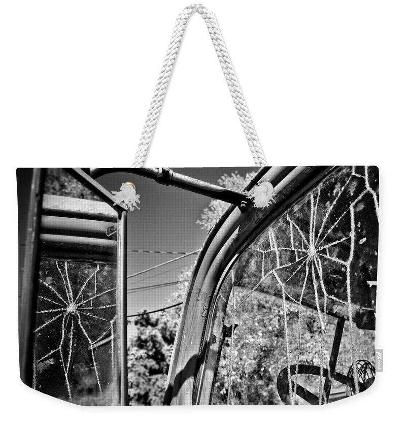 Americana Weekender Tote Bag featuring the photograph Old Cracked Glass Spider Web by Marilyn Hunt