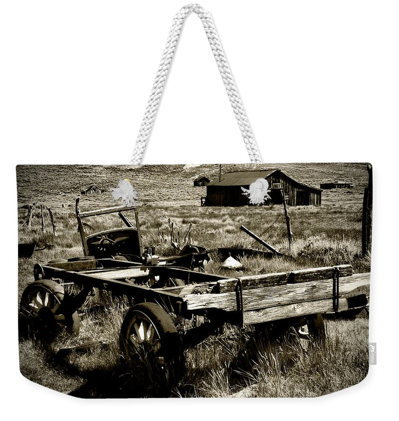 Old Fella Weekender Tote Bag featuring the photograph Old Fella by Chris Brannen