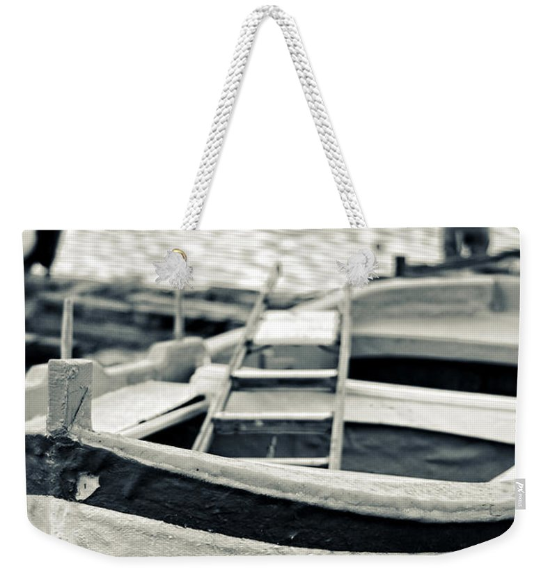 Boat Weekender Tote Bag featuring the photograph Old Man And Boat by Silvia Ganora