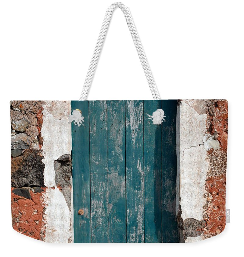Abandoned Weekender Tote Bag featuring the photograph Old Painted Door by Gaspar Avila