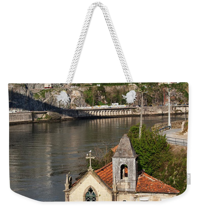 Bridge Weekender Tote Bag featuring the photograph Old Riverside Church In Portugal by Artur Bogacki