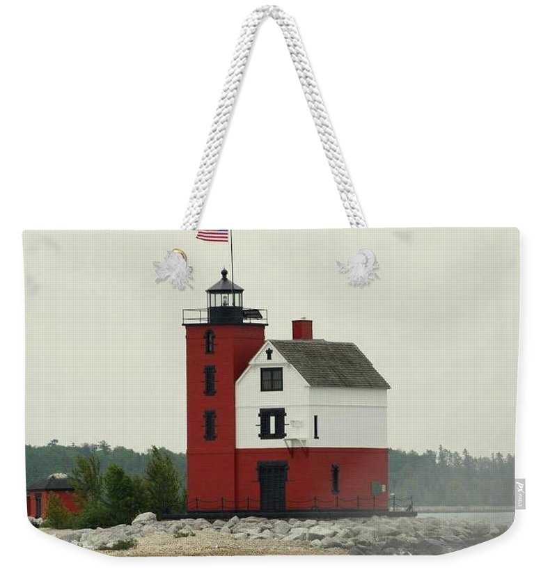 Old Weekender Tote Bag featuring the photograph Old Round Island Point Lighthouse Michigan by Anita Hiltz