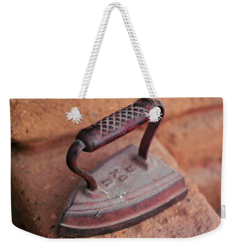 Still Life Weekender Tote Bag featuring the photograph Old Stove Iron by Jeff Swan