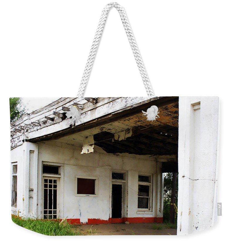 Peeling Paint Weekender Tote Bag featuring the photograph Old Texas Gas Station by Marilyn Hunt