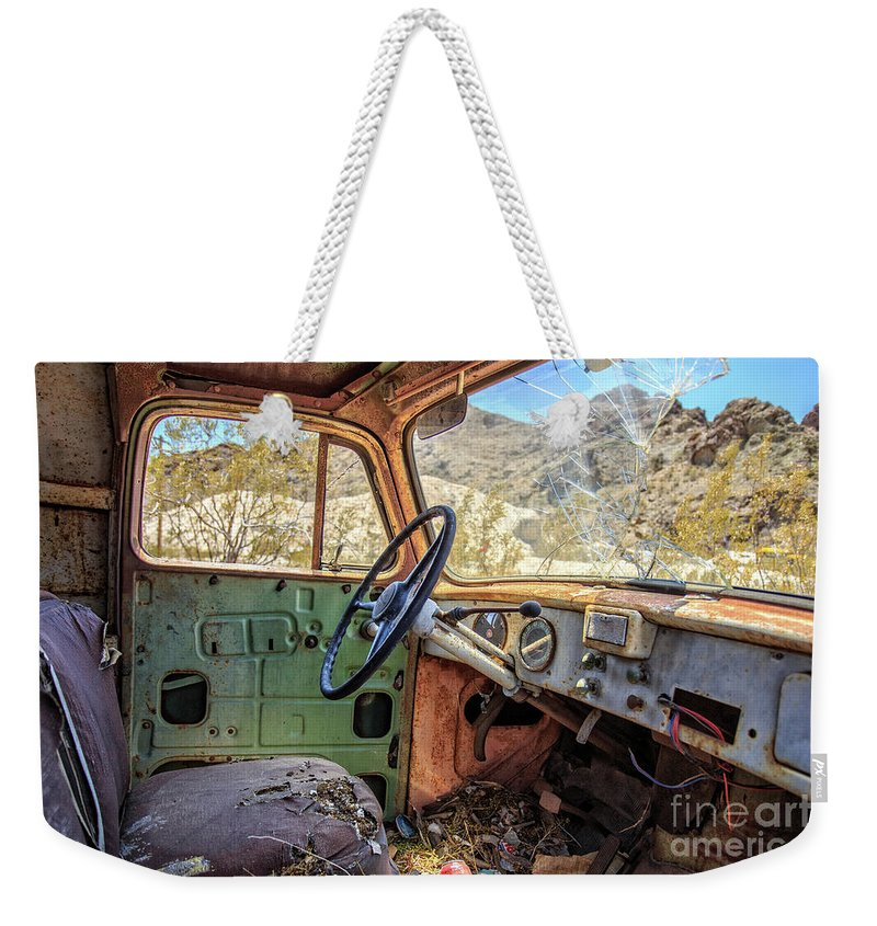 Truck Weekender Tote Bag featuring the photograph Old Truck Interior Nevada Desert by Edward Fielding