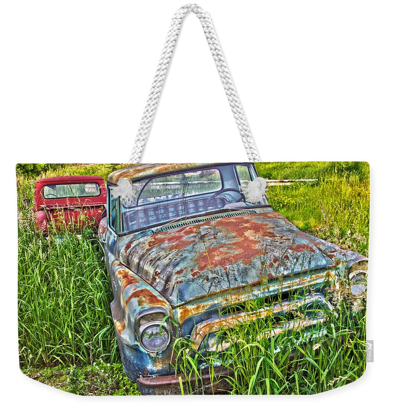 Transportation Weekender Tote Bag featuring the photograph 001 - Old Trucks by David Ralph Johnson