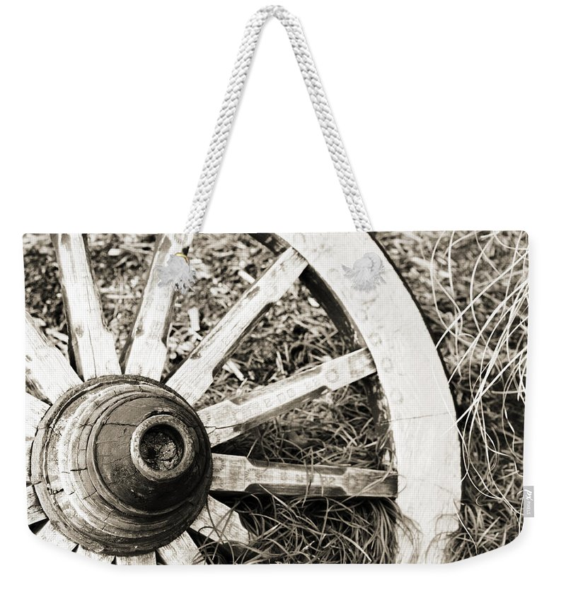 Artsy Weekender Tote Bag featuring the photograph Old Wagon Wheel by Marilyn Hunt