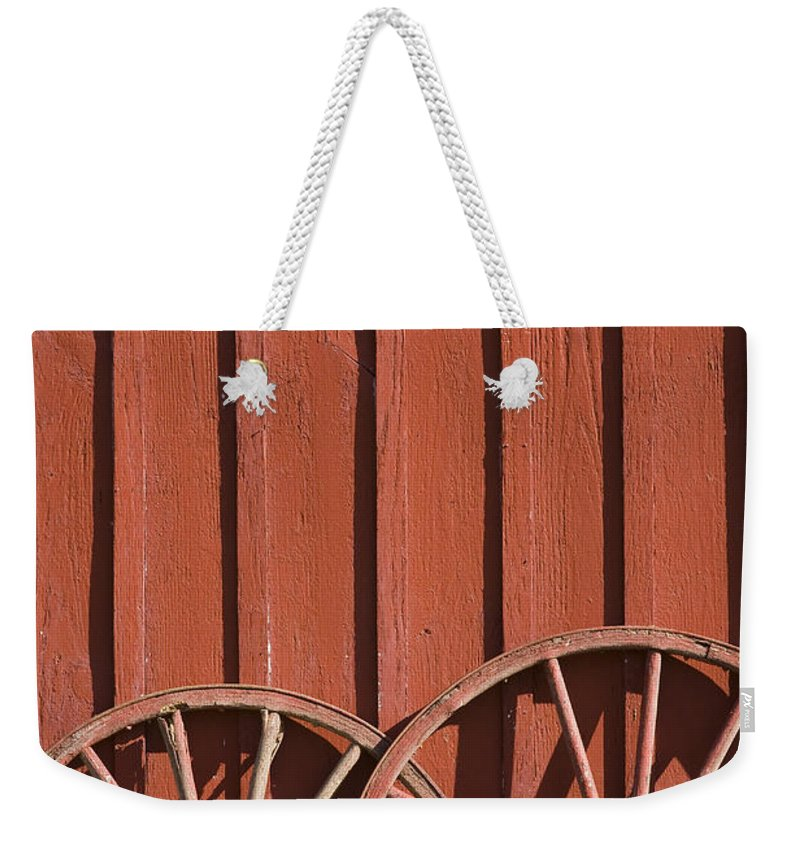 Wheel Wheels Wagon Old Red Barn Antique Past History Rural Country Weekender Tote Bag featuring the photograph Old Wagon Wheels IIi by Andrei Shliakhau
