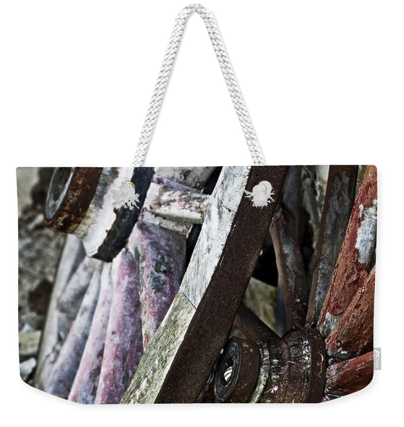 Old Weekender Tote Bag featuring the photograph Old Wagon Wheels by Marilyn Hunt