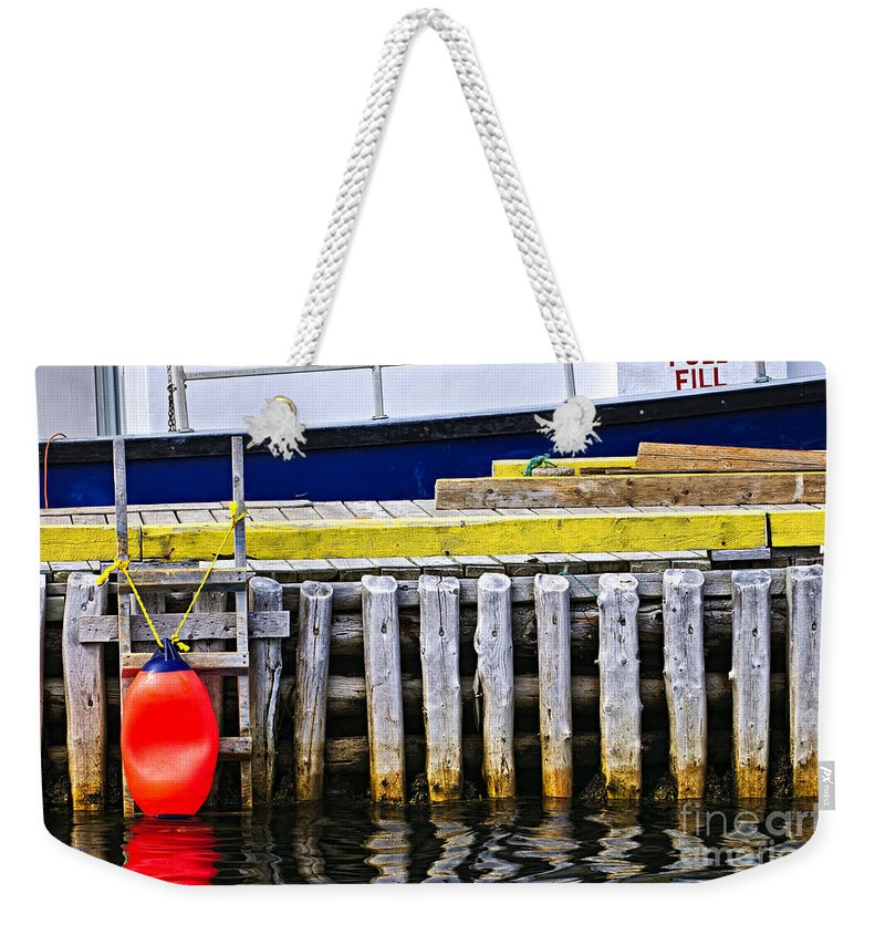 Pier Weekender Tote Bag featuring the photograph Old Wooden Pier In Newfoundland by Elena Elisseeva