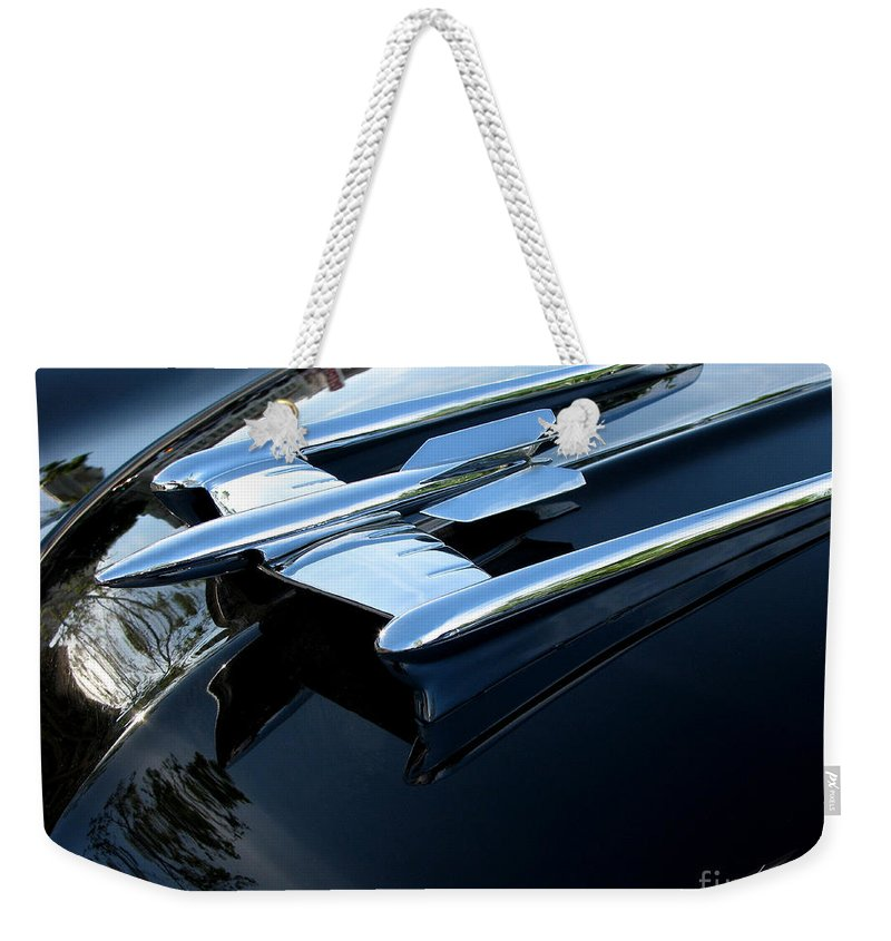 Oldsmobile 88 Weekender Tote Bag featuring the photograph Old's 88 Hood Ornament by Peter Piatt