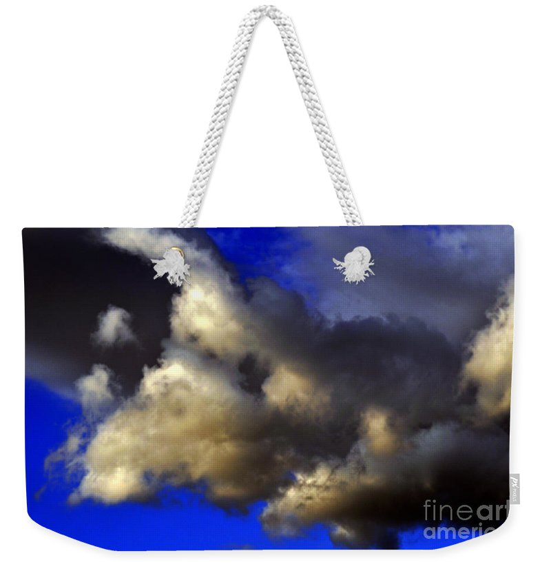 Clay Weekender Tote Bag featuring the photograph Ominous by Clayton Bruster