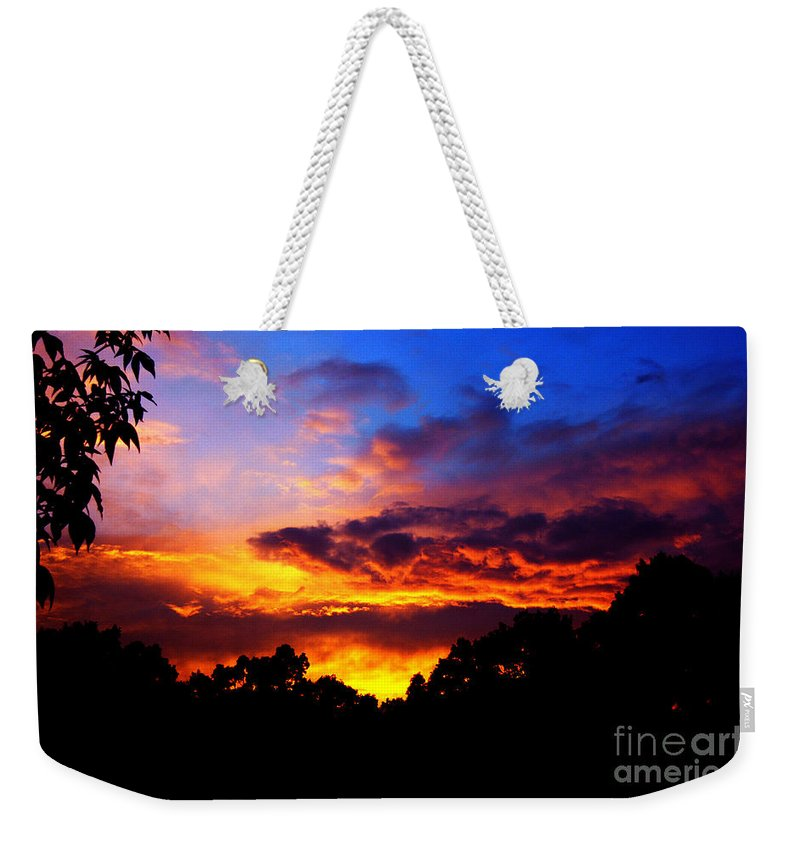 Clay Weekender Tote Bag featuring the photograph Ominous Sunset by Clayton Bruster