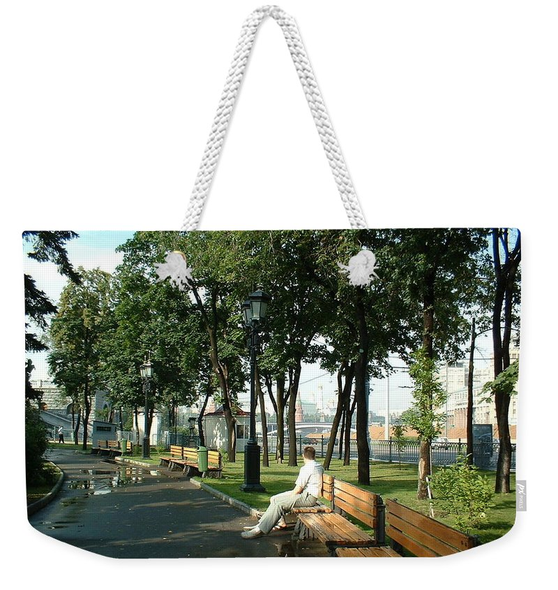 Moscow Weekender Tote Bag featuring the photograph On A Moscow Bench by James Hanemaayer