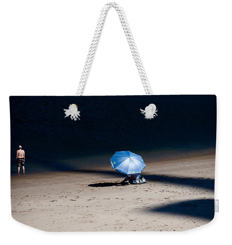 Beach Weekender Tote Bag featuring the photograph On The Beach by Dave Bowman