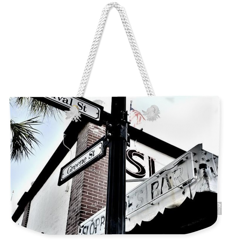 On The Corner Weekender Tote Bag featuring the photograph On The Corner by Lisa Renee Ludlum