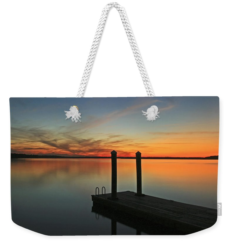 Sunset Weekender Tote Bag featuring the photograph On The Dock by Phill Doherty