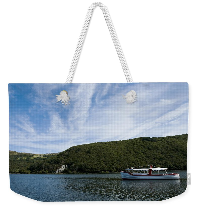 Boat Weekender Tote Bag featuring the photograph On The Lake by Svetlana Sewell
