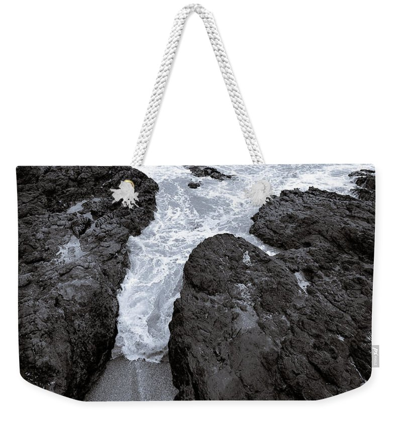 New Zealand Weekender Tote Bag featuring the photograph On The Rocks by Dave Bowman