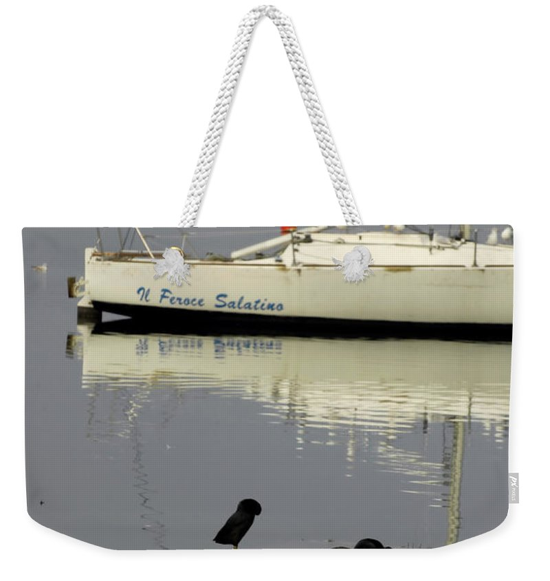 Water Weekender Tote Bag featuring the photograph On The Rocks by Guido Strambio