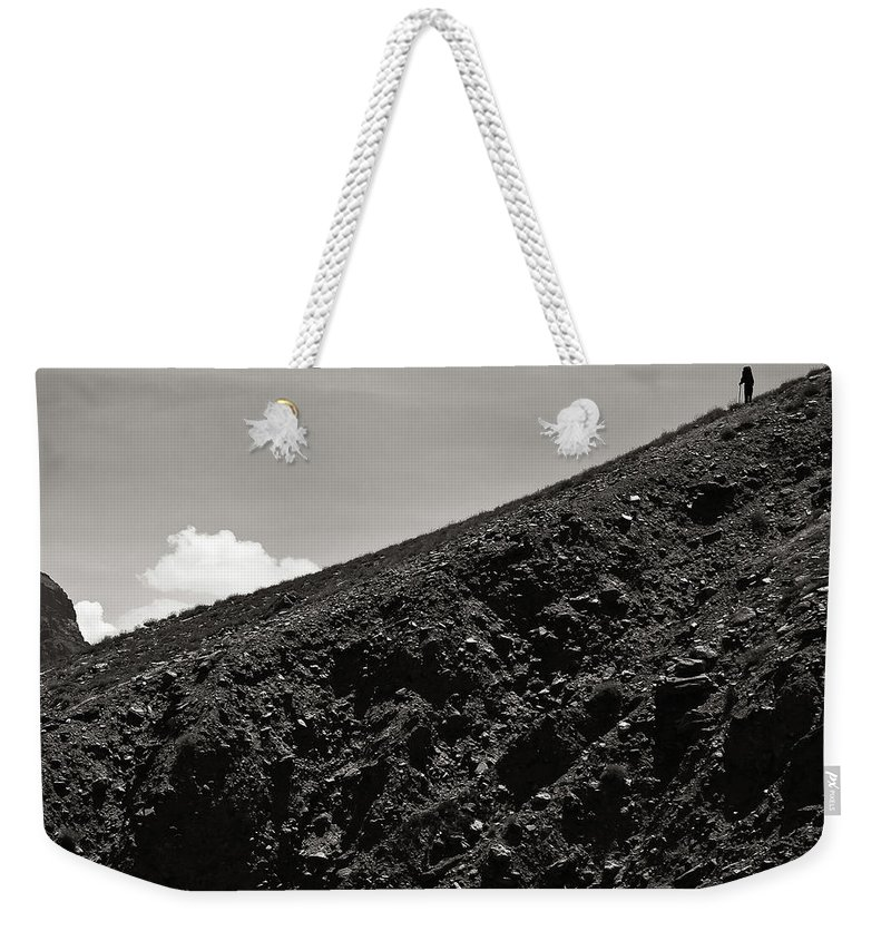 Alone Weekender Tote Bag featuring the photograph On The Slope by Konstantin Dikovsky