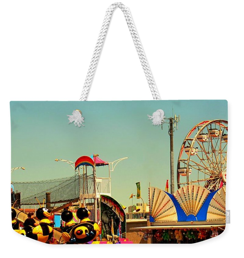 Canadian Weekender Tote Bag featuring the photograph Once A Year by Ian MacDonald