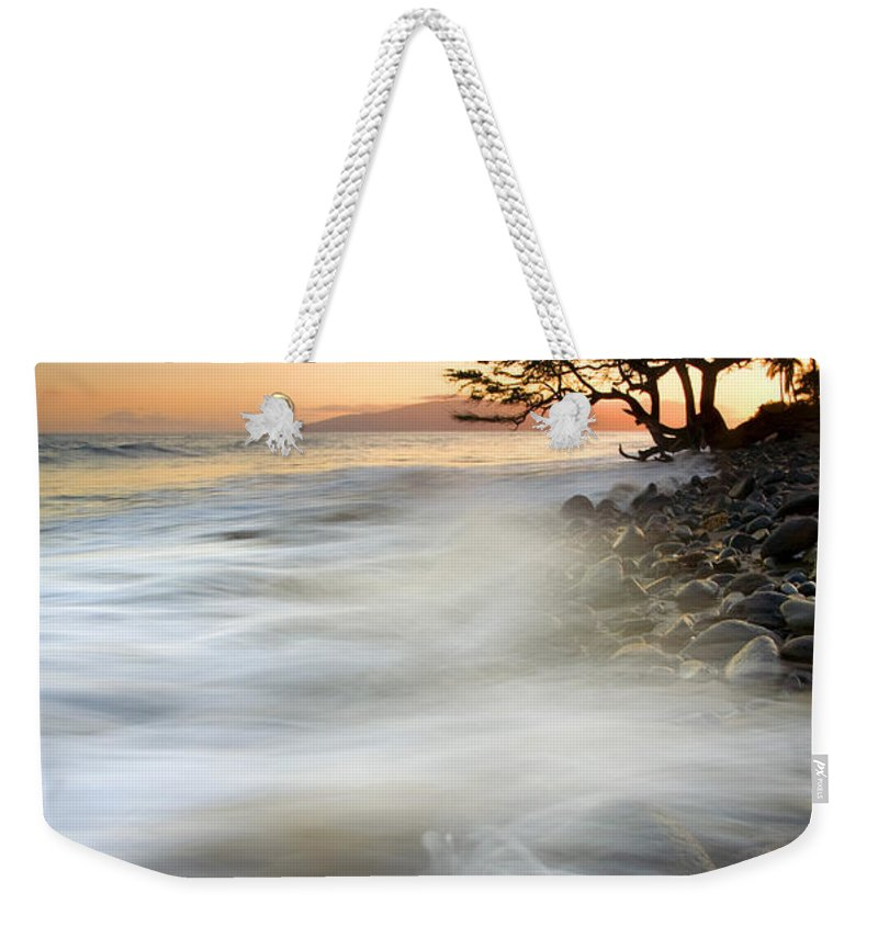 Sunset Weekender Tote Bag featuring the photograph One Against The Tides by Mike Dawson