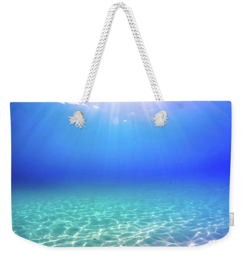 Turquoise Weekender Tote Bag featuring the photograph One Deep Breath by Nicklas Gustafsson
